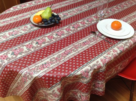 red provencal coated tablecloth that can be wiped over