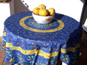 blue and yellow 60 in round coated tablecloth