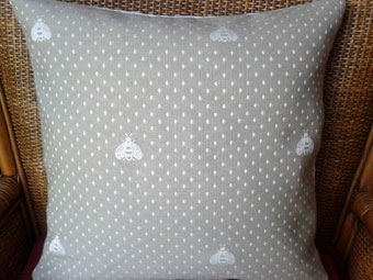 pique cushion with bees design