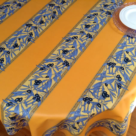 blue and yellow plastic coated French tablecloth with olive designs