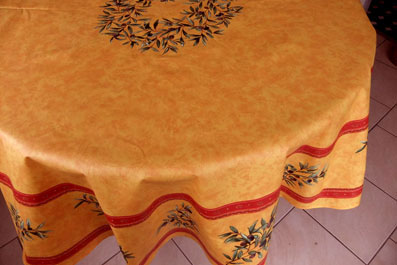 yellow coated round cloth with olives