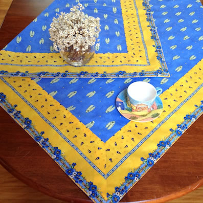 provence tablecloth with blue cicada and yellow border