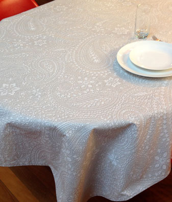 french coated tablecloth with paisley designs in blue tones