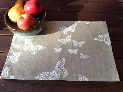 coated linen table mats with butterflies designs