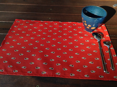 red and gold coated table mats