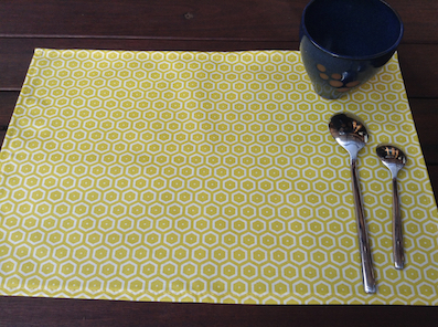 yellow coated placemats
