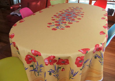 large oval coated tablecloth with poppies design