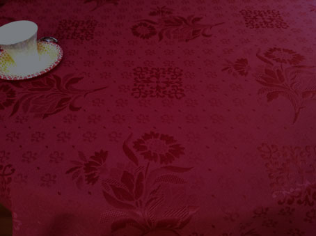 light pique woven French tablecloth in cherry red tones
